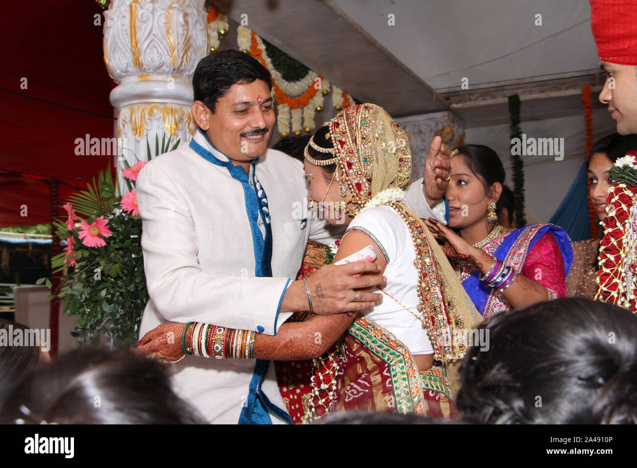 Amreli; Gujarat; India -Asia ; The Emotions of Father and Daughter are Totally Different Bidaai/viday Ceremony In Traditional Indian Hindu Wedding. Stock Photo