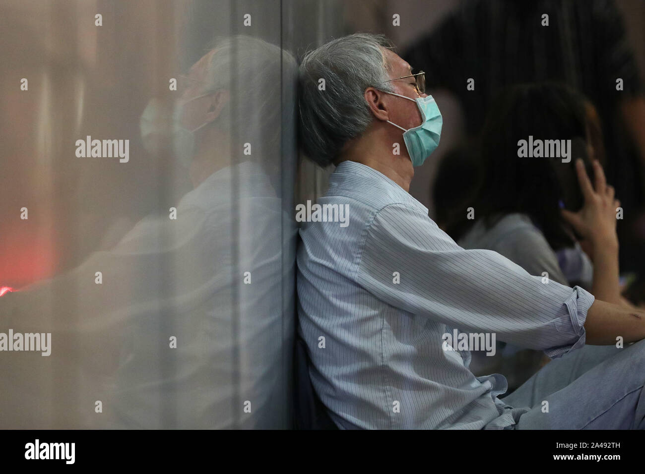 Hong Kong, China. 12th Oct, 2019. Member of the sliver hair sleeping outside police headquarters during the protests. Hong Kong Protests continue for the 5th month. More demonstrations and rallies have taken place including the silver hair, a 48 hours strike of sitting peacefully outside police headquarters. Credit: SOPA Images Limited/Alamy Live News Stock Photo