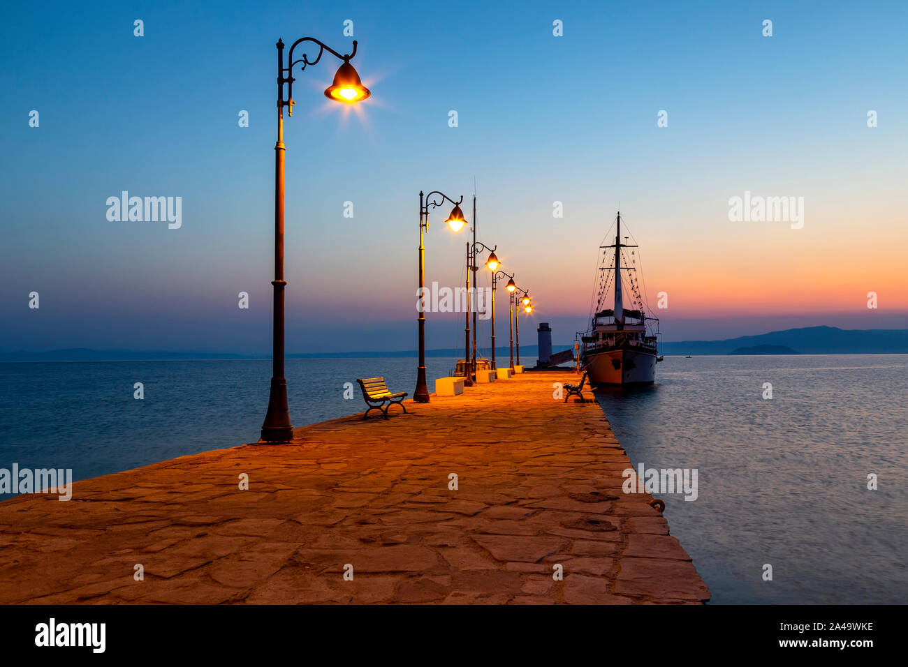 Wooden motor boat at sunrise, used for tourist trips on the sea, Pefkohori, Greece Stock Photo