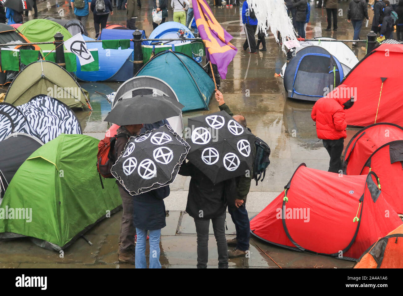 London, UK - 13 October 2019. Claimate activists from Extinction Rebellion continue their protest as they camp out in Trafalgar Square in an attempt to force the government to declare a climate emergency and meet their demands to reduce to zero carbon emmissions by 2025. Credit: amer ghazzal/Alamy Live News Stock Photo