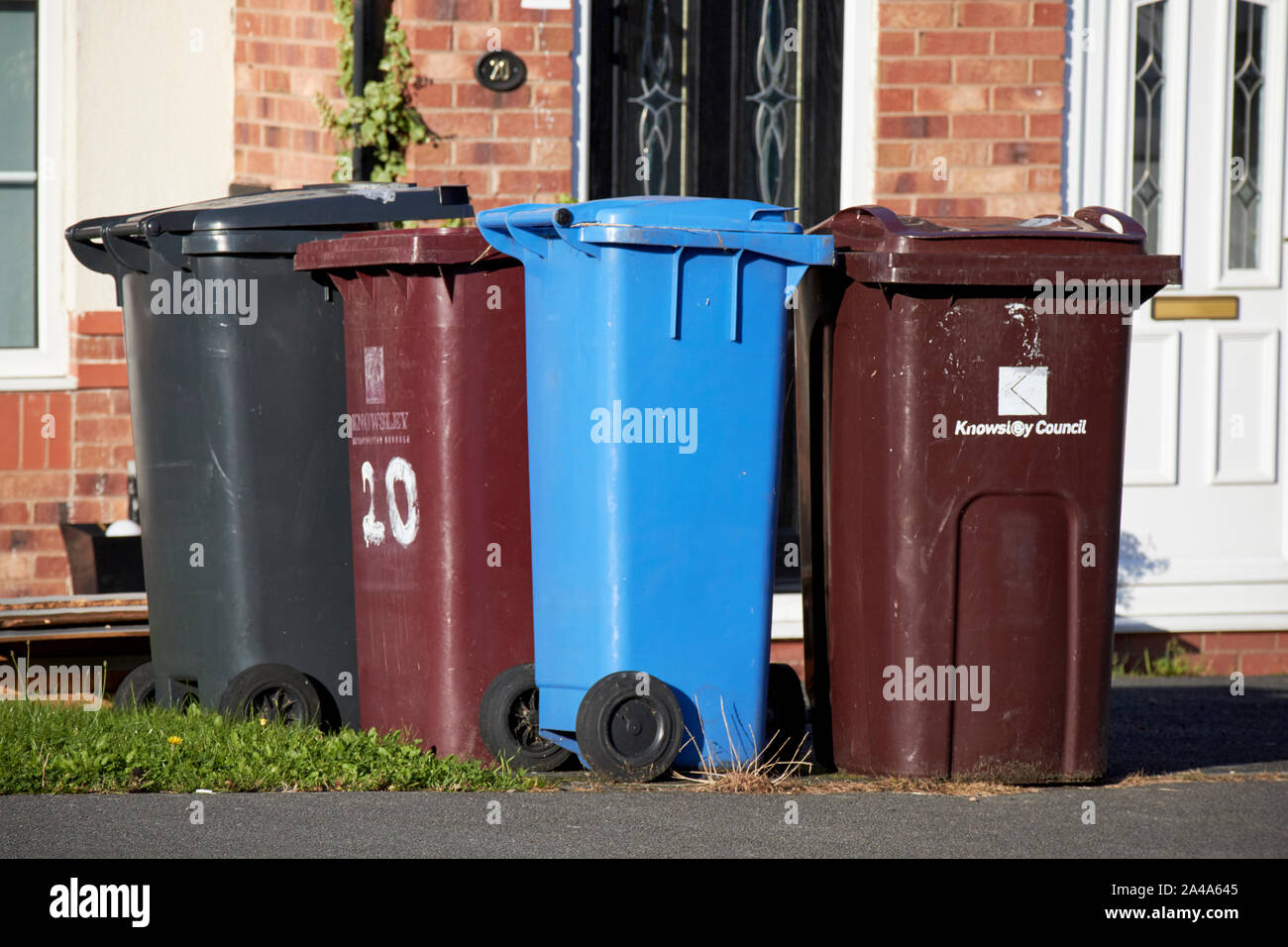 various recycling wheelie bins outside houses in Liverpool England UK Stock Photo