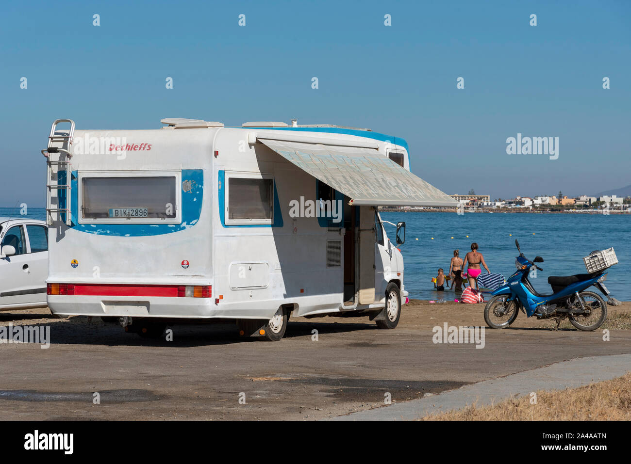 Gouves, Crete, Greece. October 2019. An old motorhome on the beach at Kato Gouves on an area which had been a US military base near Heraklion, Crete. Stock Photo