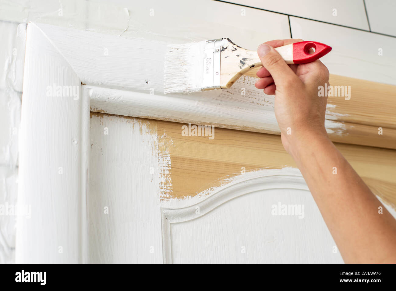 Home Repairs Hand With A Brush Paints A Wooden Door Frame In White Color In The Bathroom Close Up Stock Photo Alamy
