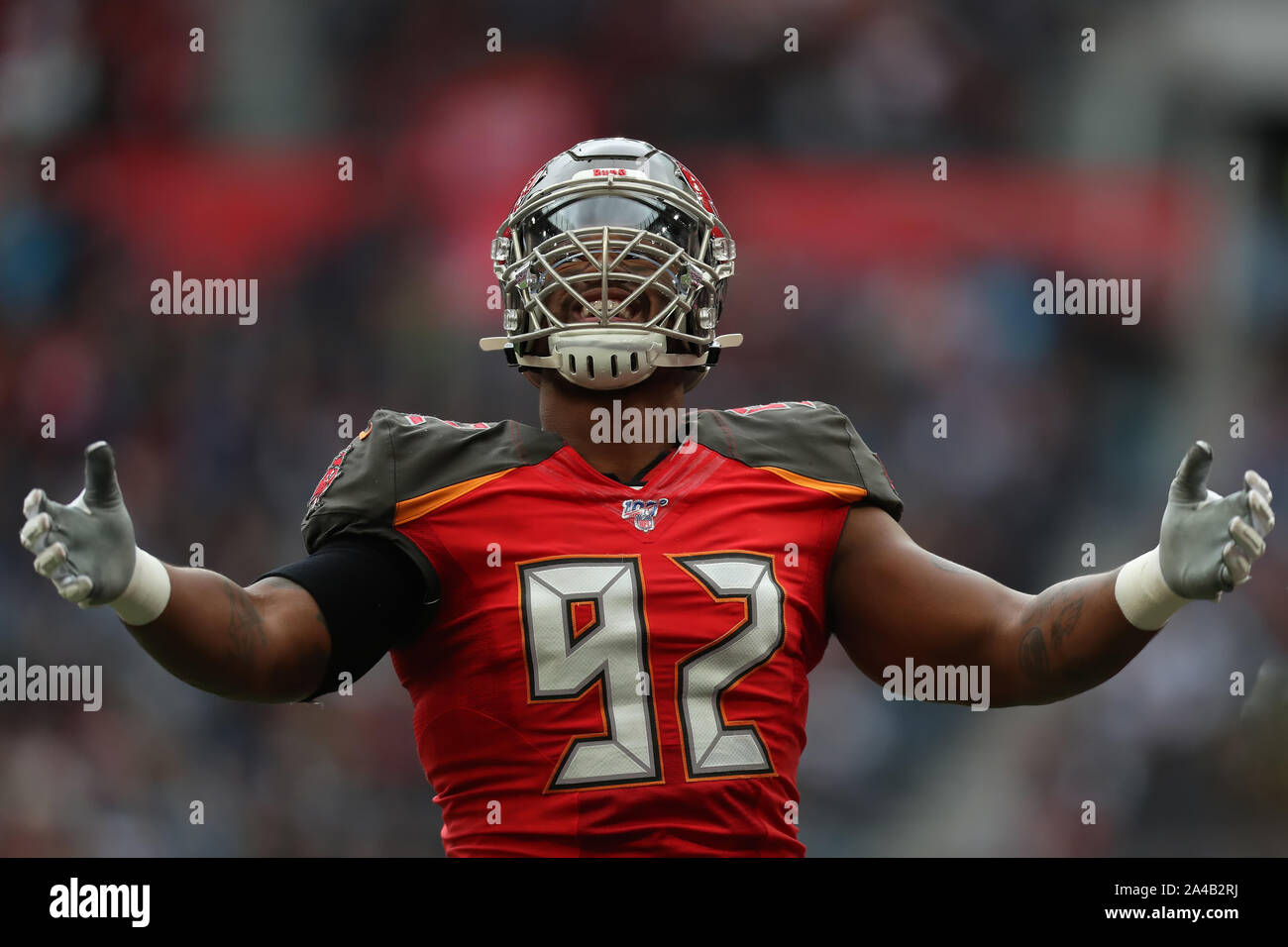 Tottenham Hotspur Stadium, London, UK. 13th Oct, 2019. National Football League, Carolina Panthers versus Tampa Bay Buccaneers; Tampa Bay Buccaneers Defensive Linesman William Gholston (92) celebrates in front of the Buccaneers crowd -Editorial Use Credit: Action Plus Sports/Alamy Live News Stock Photo