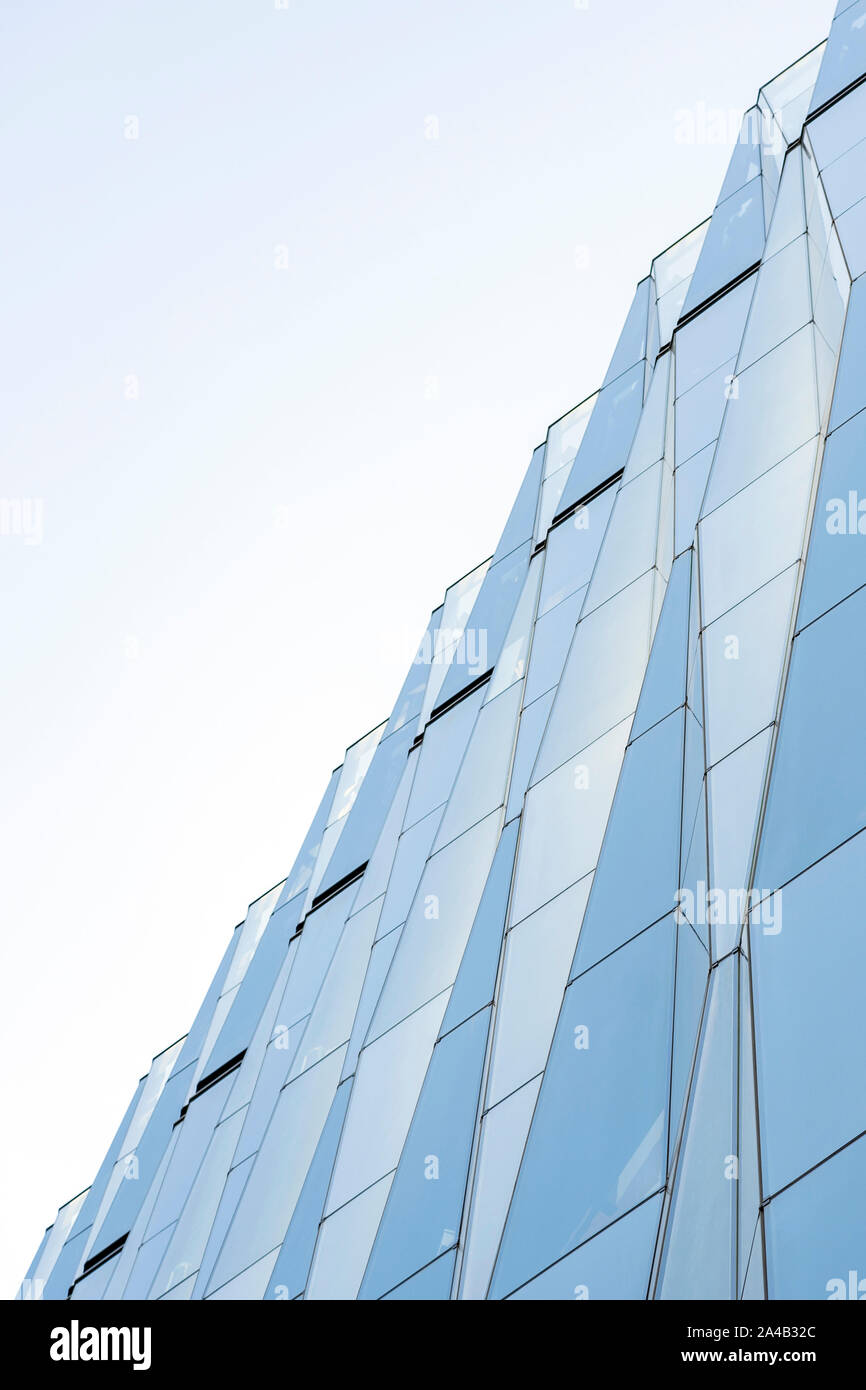Closeup View Of Diamond Shape Curtain Walls. Clear Glass Crystal Windows Of Building. Spandrel Facade System And Sky Stock Photo