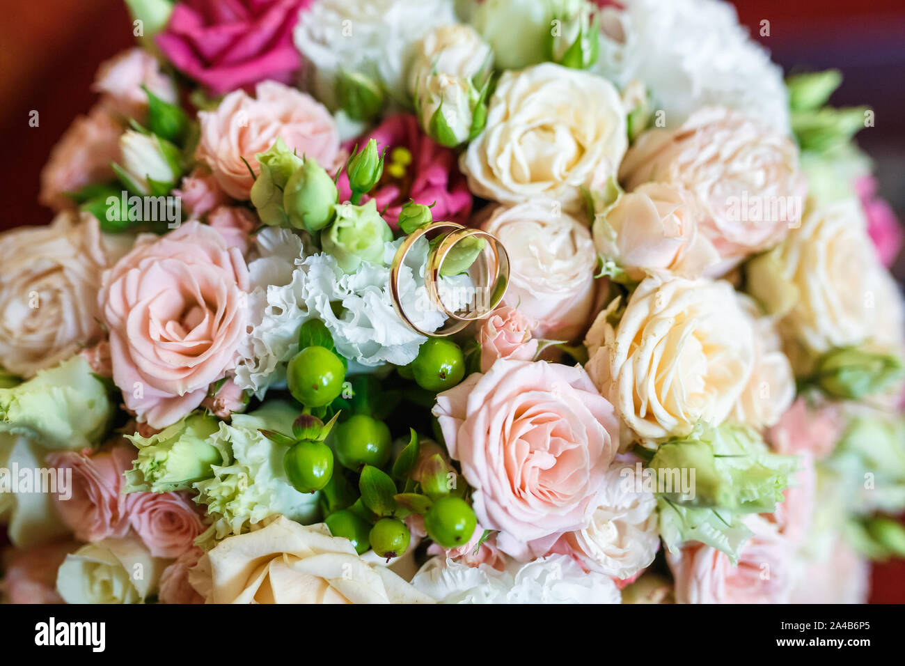 Bright Wedding Bouquet Of Summer White Pink Roses With Wedding Rings Stock Photo Alamy