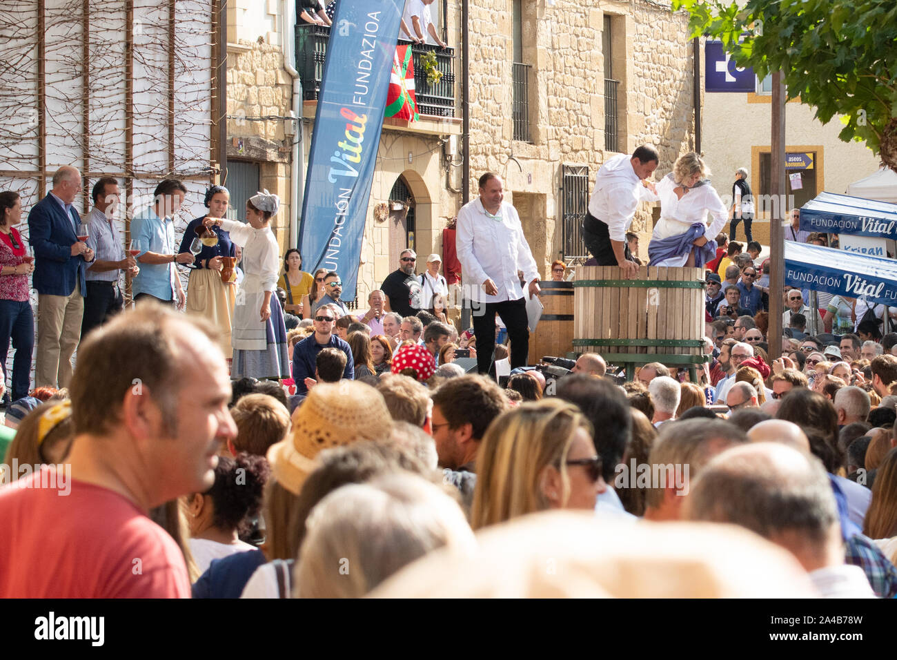 Rioja Alavesa wine harvest festival 2019 - grape stomping and tasting of the first must (grape juice from the crushed grapes), Banos de Ebro, Spain Stock Photo