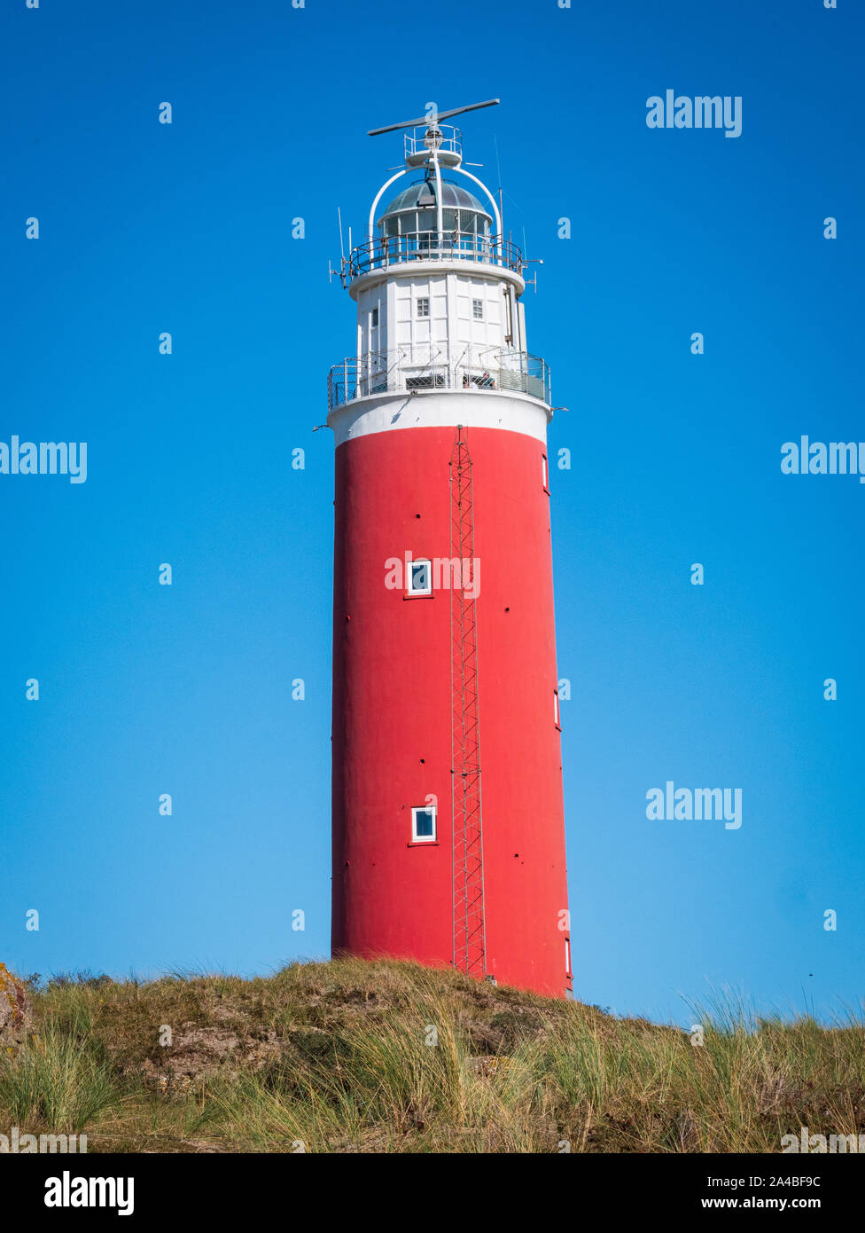 View of the Eierland Lighthouse next to the dunes of Texel in The Netherlands. Stock Photo