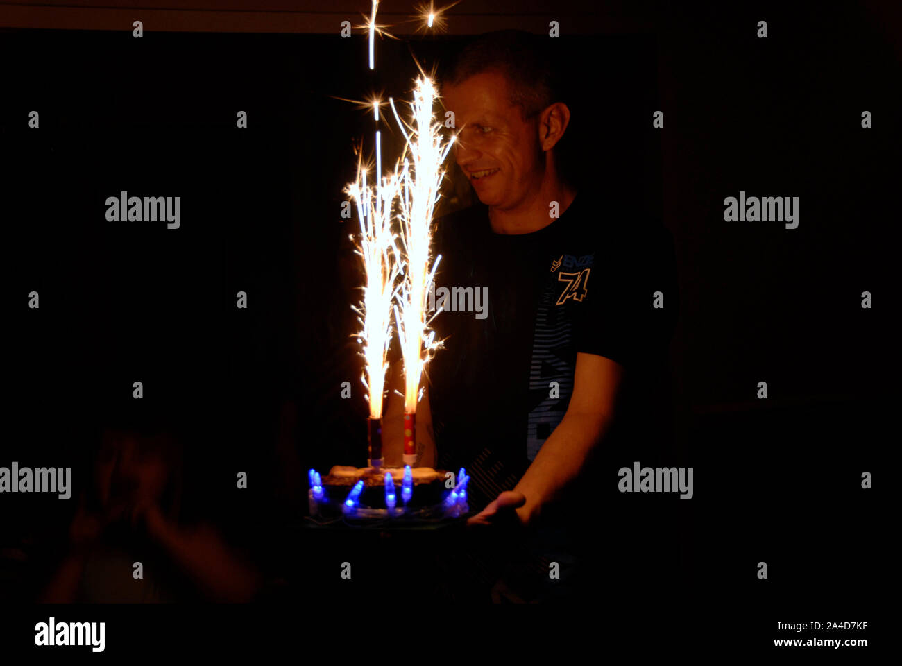 Surprising Young Man With Birthday Cake With Sparklers For Child Stock Photo Funny Birthday Cards Online Hendilapandamsfinfo