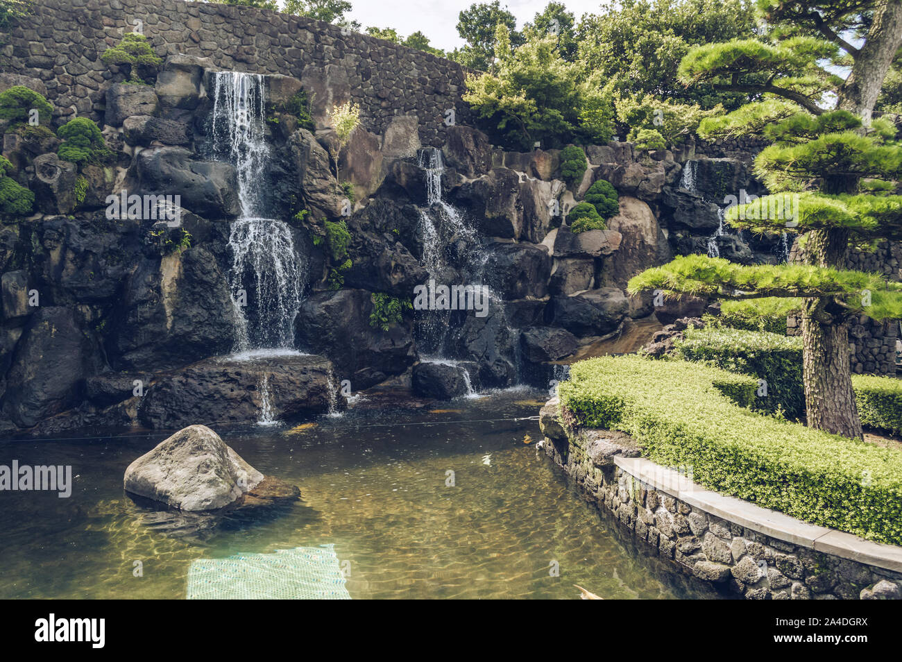 Jeju Island, South Korea, september 05, 2019: scenic view of waterfall inside of spirited garden Stock Photo