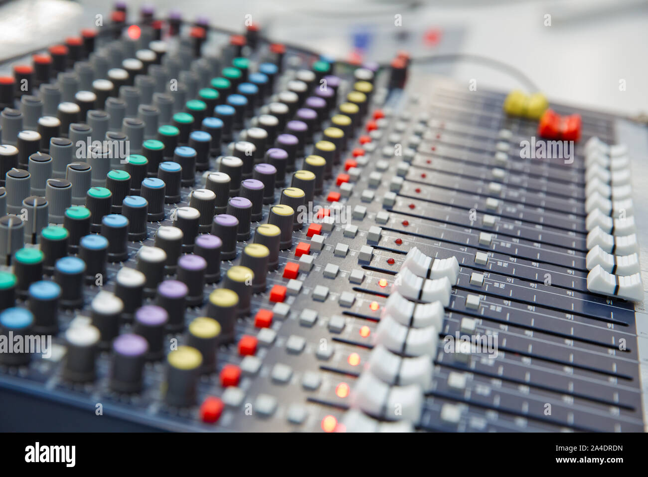The part of Musical amplifier Sound amplifier or Music mixer with Knobs and Jack holes . Picture of Musical amplifier Sound amplifier or Music mixer w Stock Photo