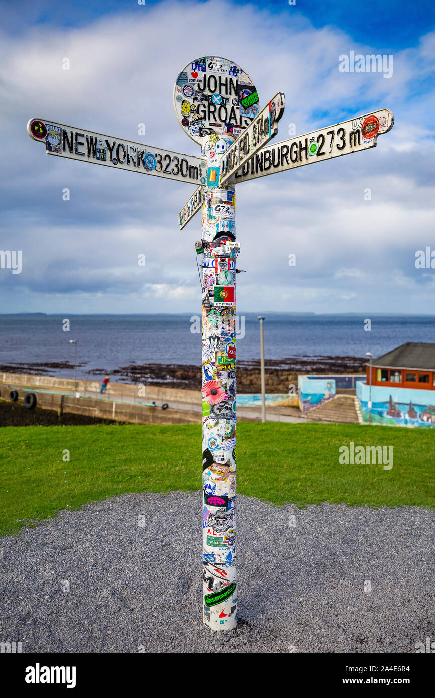 John O'Groats Signpost covered in stickers Stock Photo