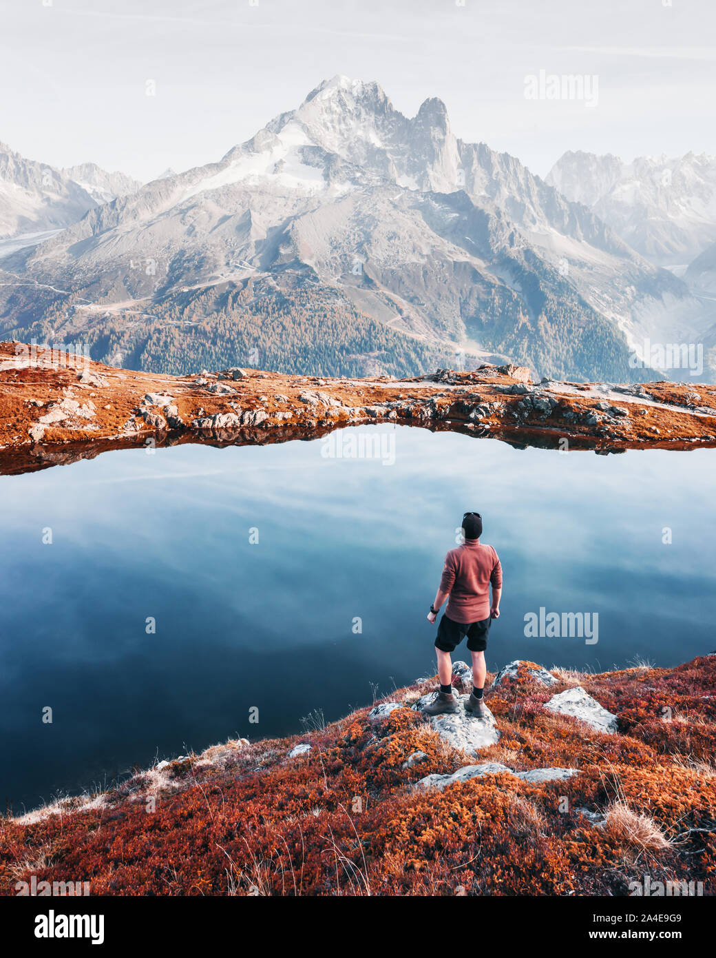 Amazing view on Monte Bianco mountains range with tourist on a foreground. Lac de Cheserys lake, Chamonix, Graian Alps. Landscape photography Stock Photo