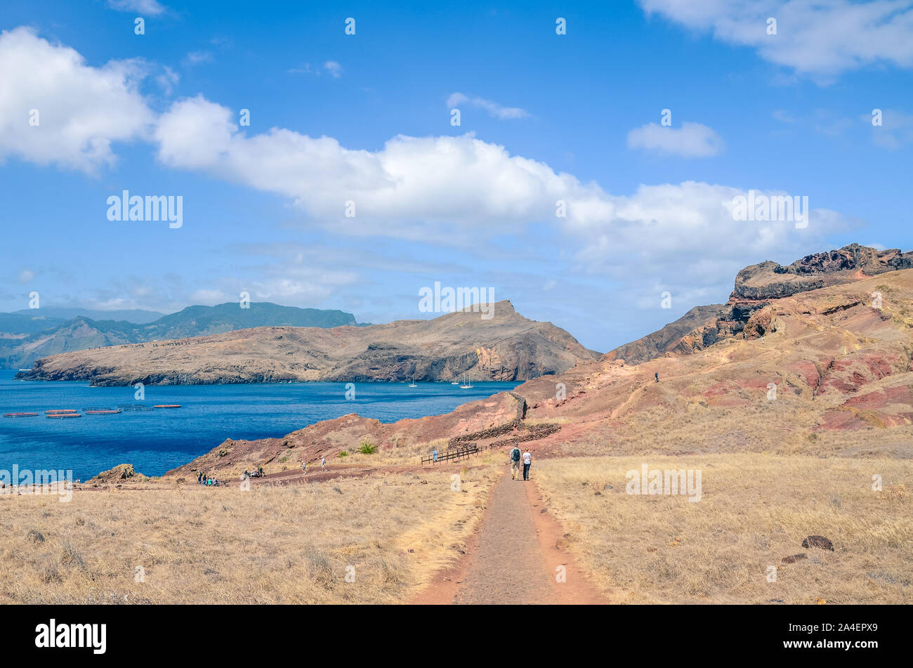 Tourists hiking in Ponta de Sao Lourenco in Madeira, Portugal. The easternmost point of the Portuguese island. Volcanic landscape. Hilly, rocky terrain. Volcanic soil. Hikers on a path. Stock Photo