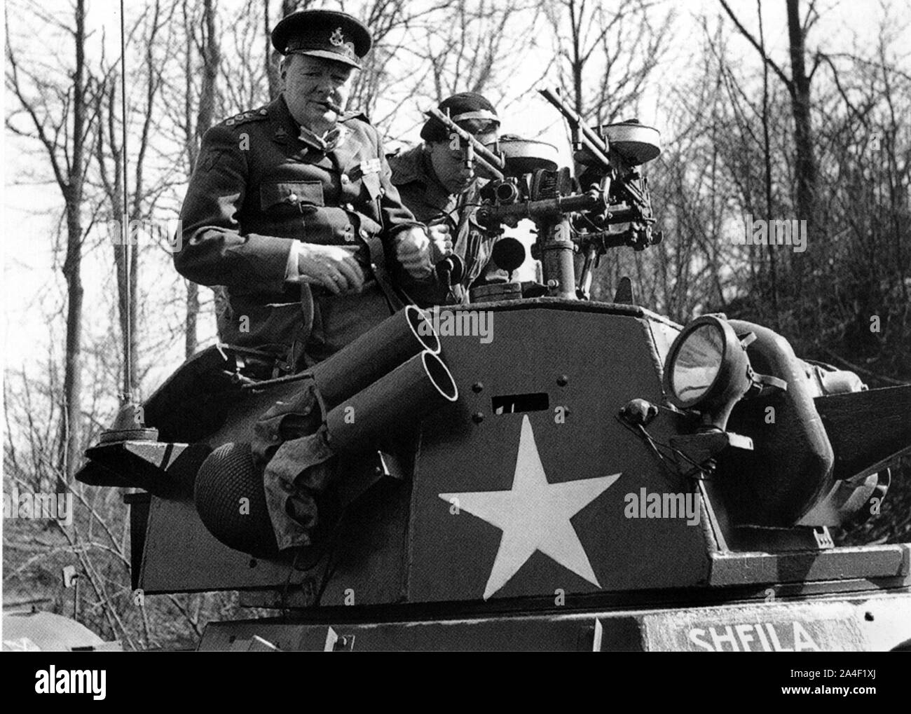 Winston Churchill aboard and American armoured car touring territory recently won from the Germans. March 1945 Stock Photo