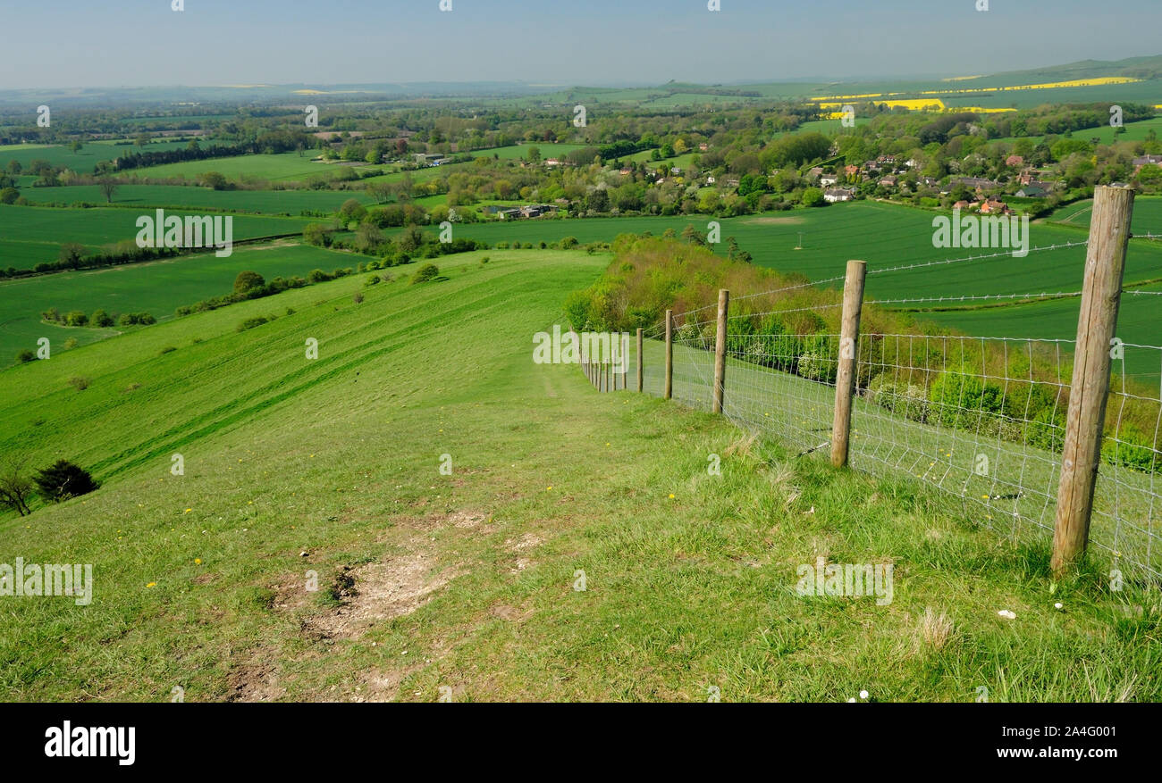 The route of the White Horse Trail descending from the Giants Grave earthwork towards the village of Oare in the Vale of Pewsey, Wiltshire. Stock Photo
