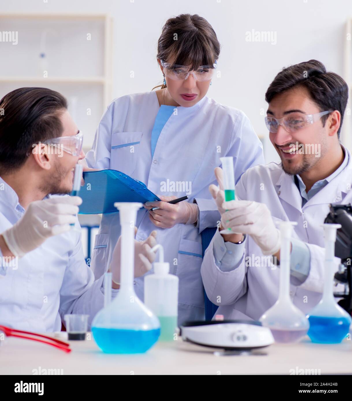 The team of chemists working in the lab Stock Photo