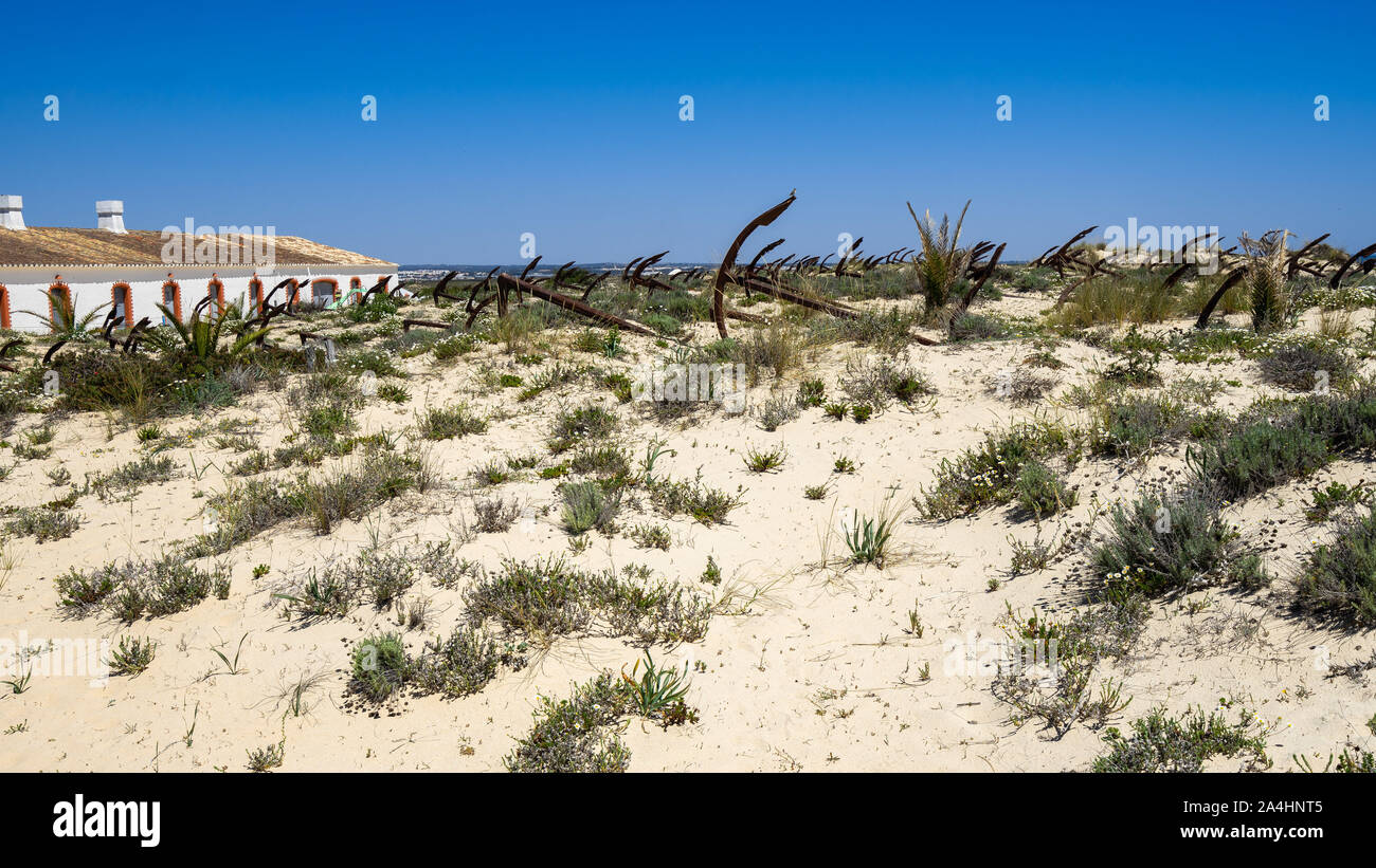 The scenic Anchors Cemetery laying among the dunes of Barril beach near Tavira, Algarve, Portugal Stock Photo