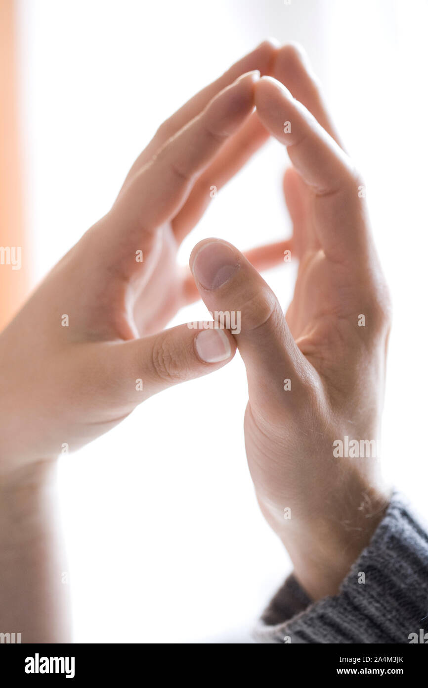 Couple's hands touching Stock Photo