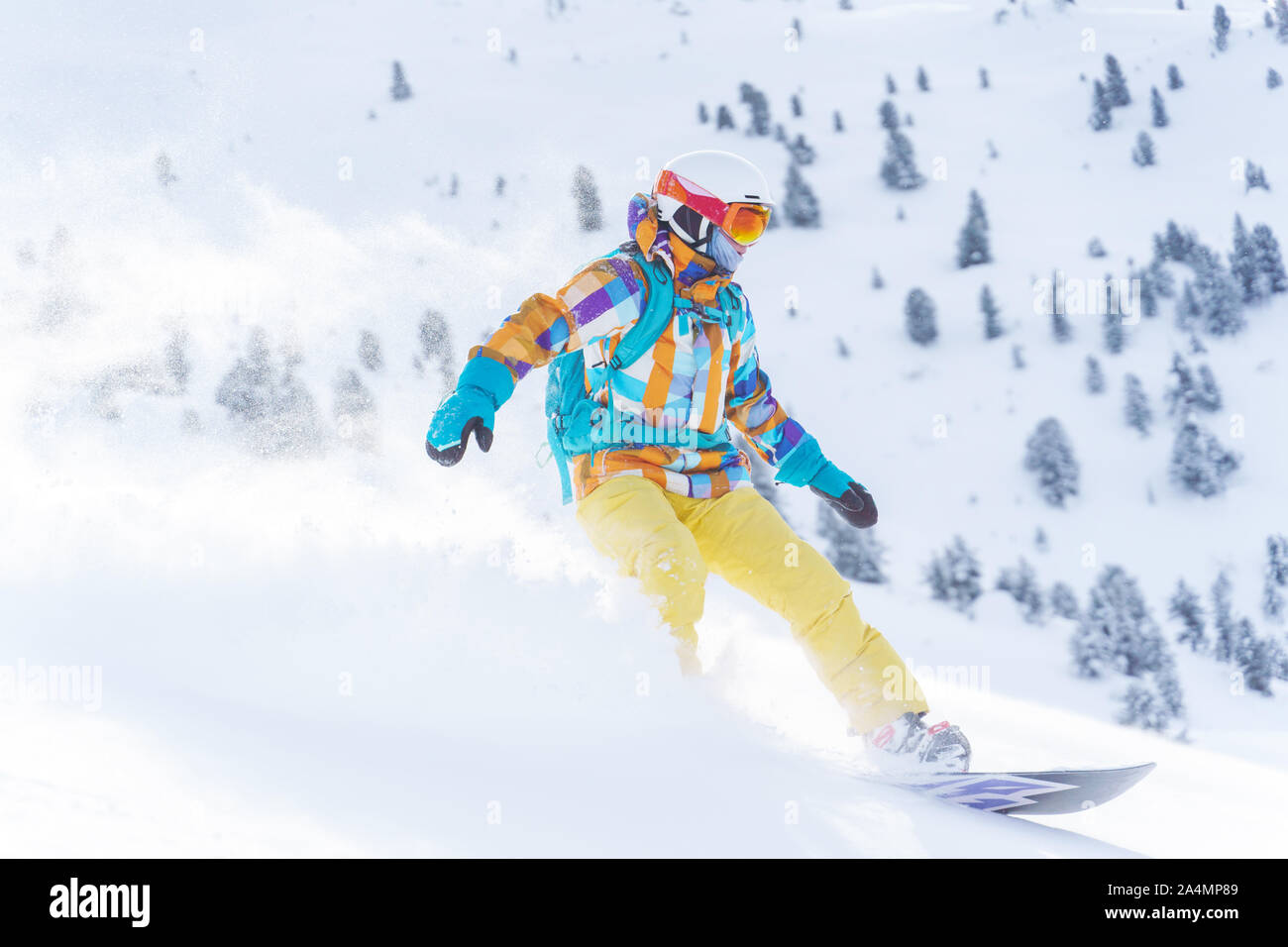 Young Sports Girl In Helmet And Mask Is Riding On Snowboard