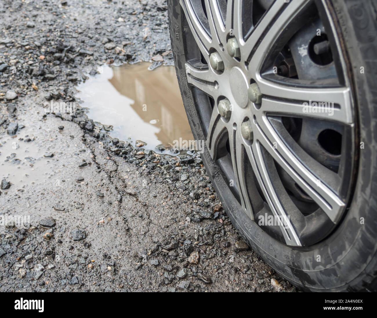 Pothole in the street Stock Photo