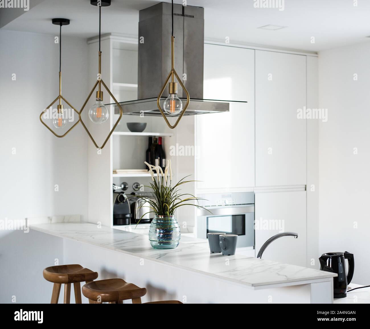 Beautiful interior design house and modern white kitchen Stock Photo