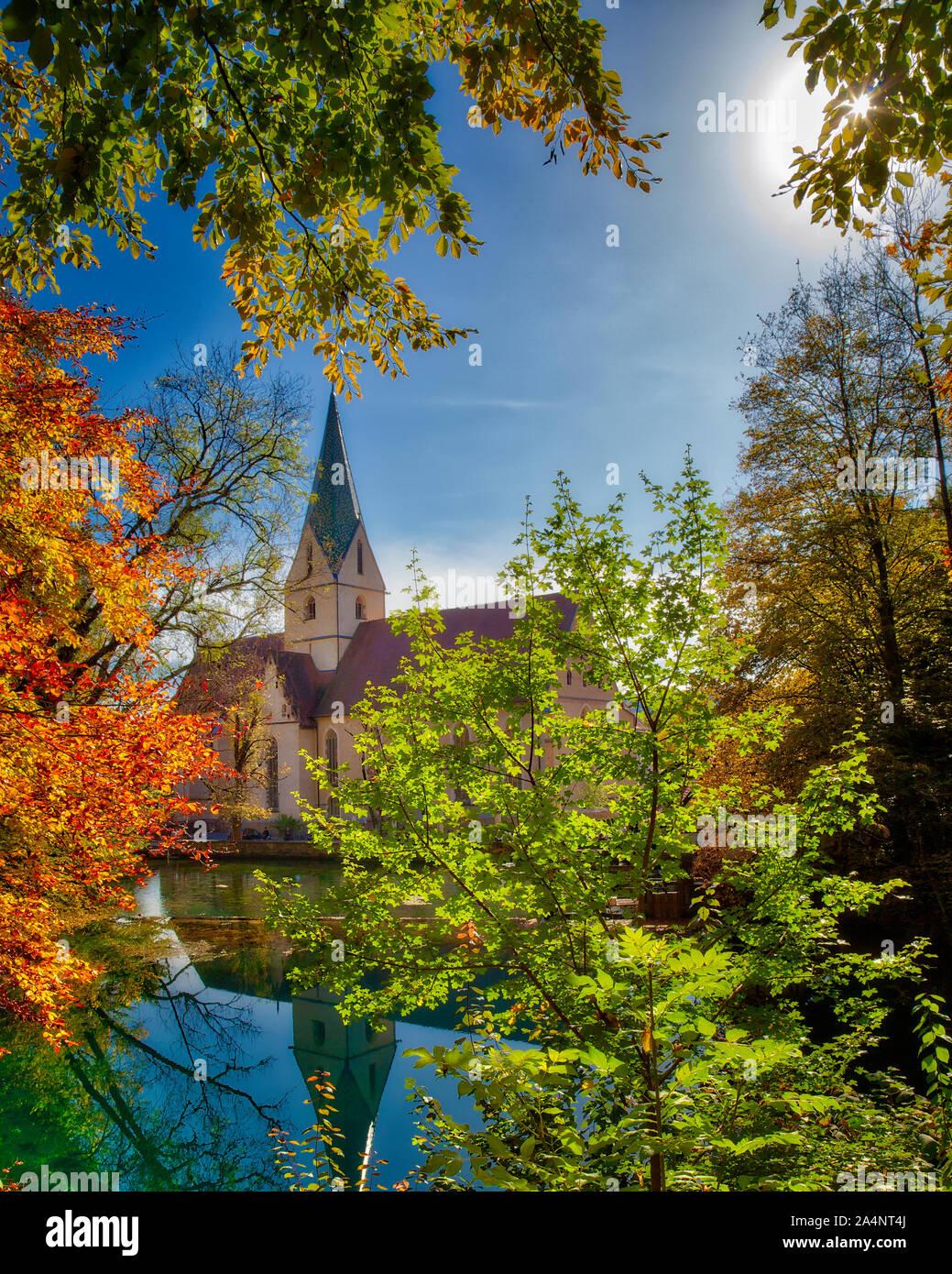 DE - BADEN-WÜRTTEMBERG: The Blautopf and Blaubeuren Abbey  (A UNESCO World Heritage Site) Stock Photo