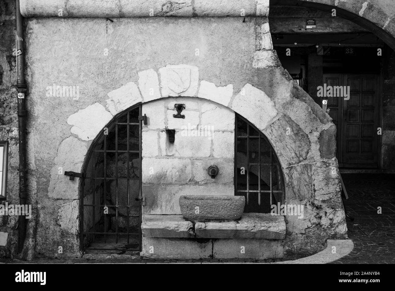 Black and white image of water well in Annecy, France Stock Photo