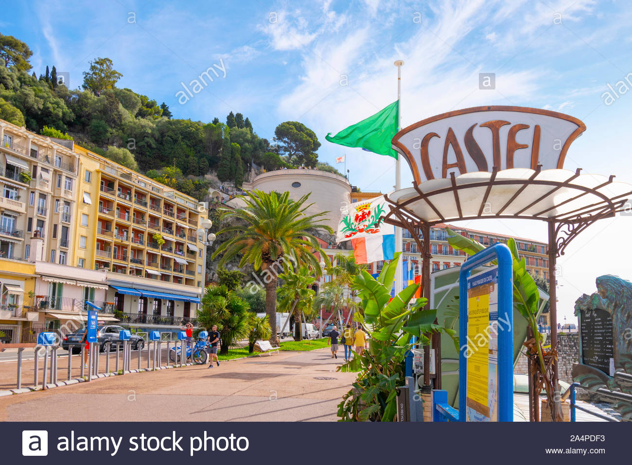 View of Castle Hill from the Promenade in front of Castel Plage and restaurant in Old View Nice France on the French Riviera. Stock Photo