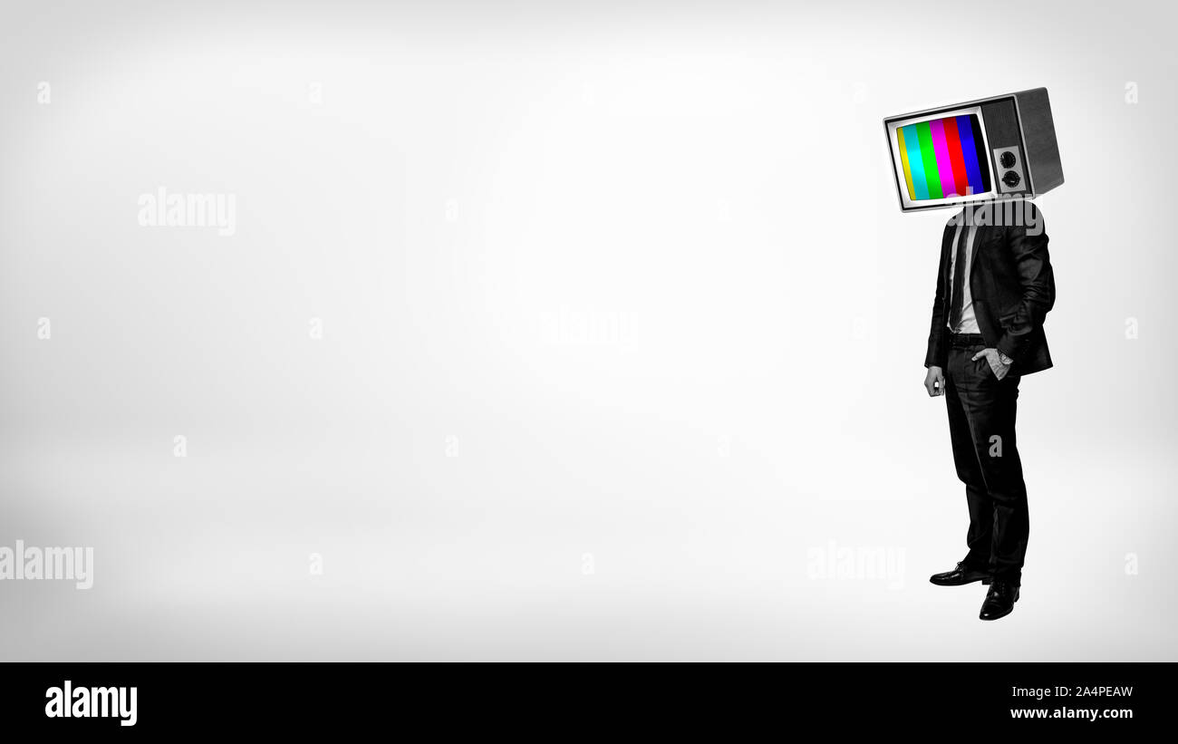 A businessman in a high contrast stands with one arm in a pocket and a TV with color bars instead of his head. Stock Photo