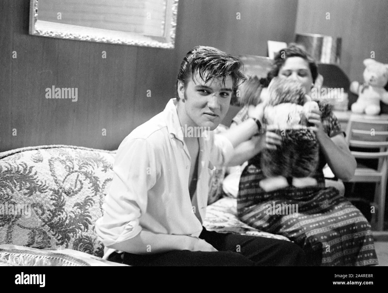 Elvis Presley with his mother Gladys Presley, in the living room at 1034 Audubon Drive, Memphis, Tennessee, May 29, 1956 Stock Photo