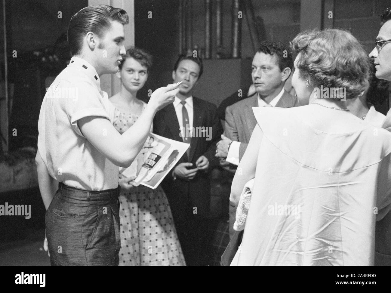 Elvis Presley backstage with fans at the University of Dayton Fieldhouse, May 27, 1956. Stock Photo