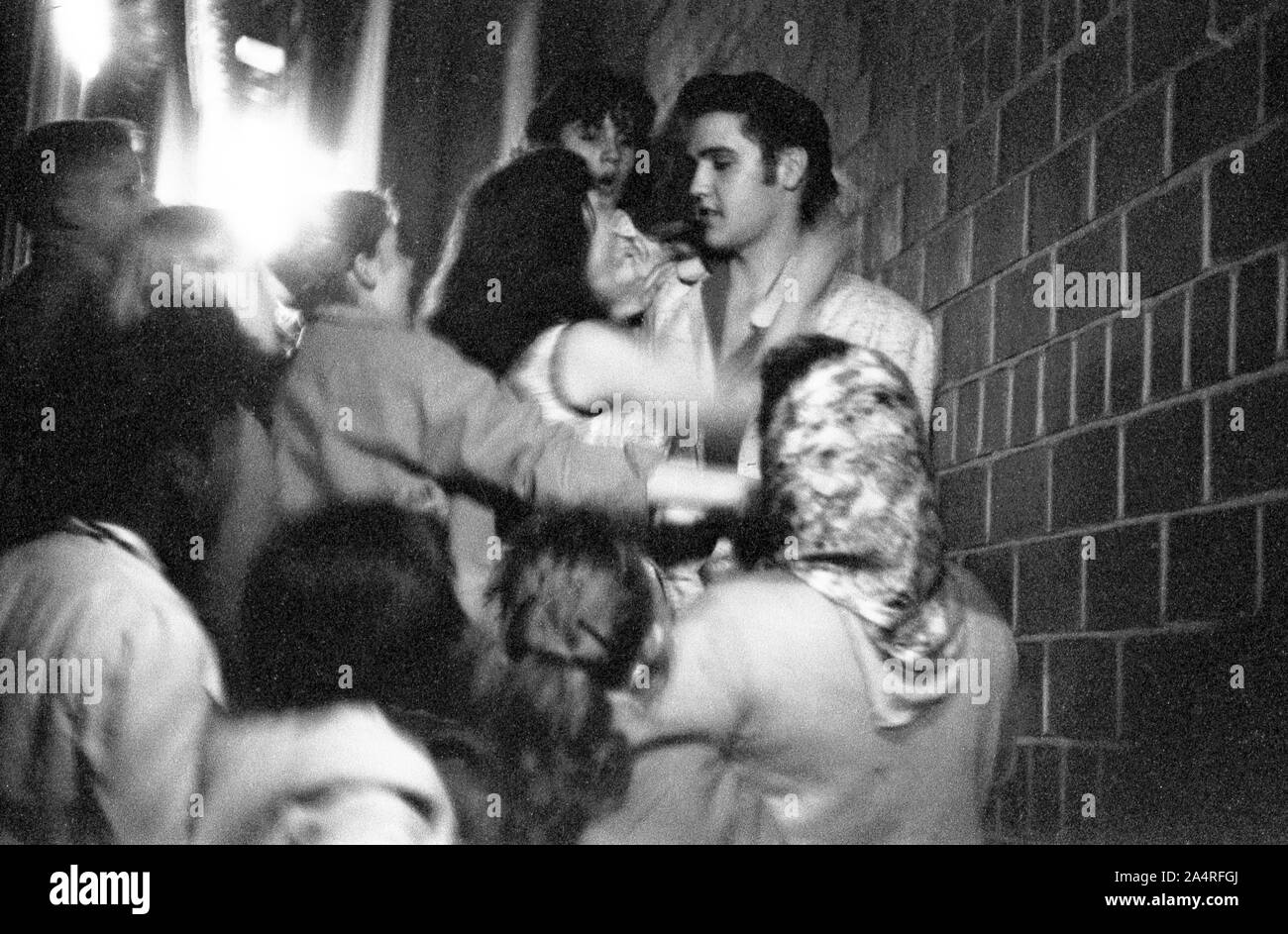 Elvis Presley being swarmed by fans at the University of Dayton Fieldhouse, May 27, 1956. Stock Photo