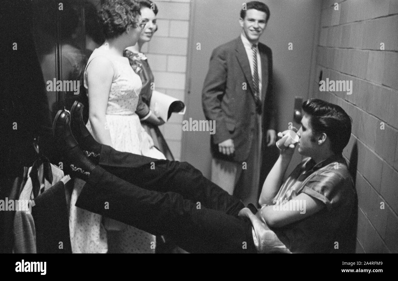 Elvis Presley, talking with fans backstage at the University of Dayton Fieldhouse, May 27, 1956. Stock Photo