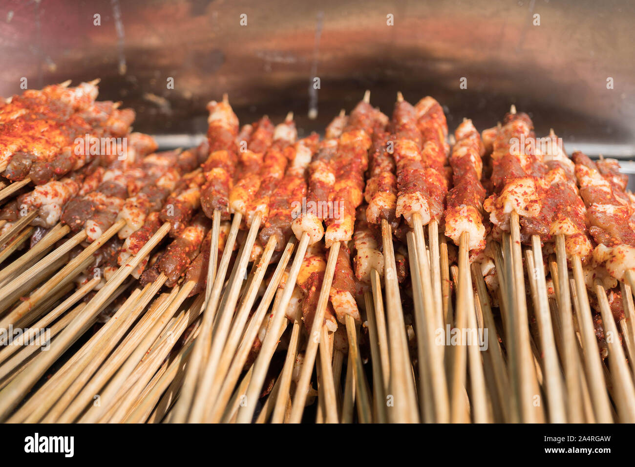 Spicy mala seasoned meat on stick for grill Stock Photo