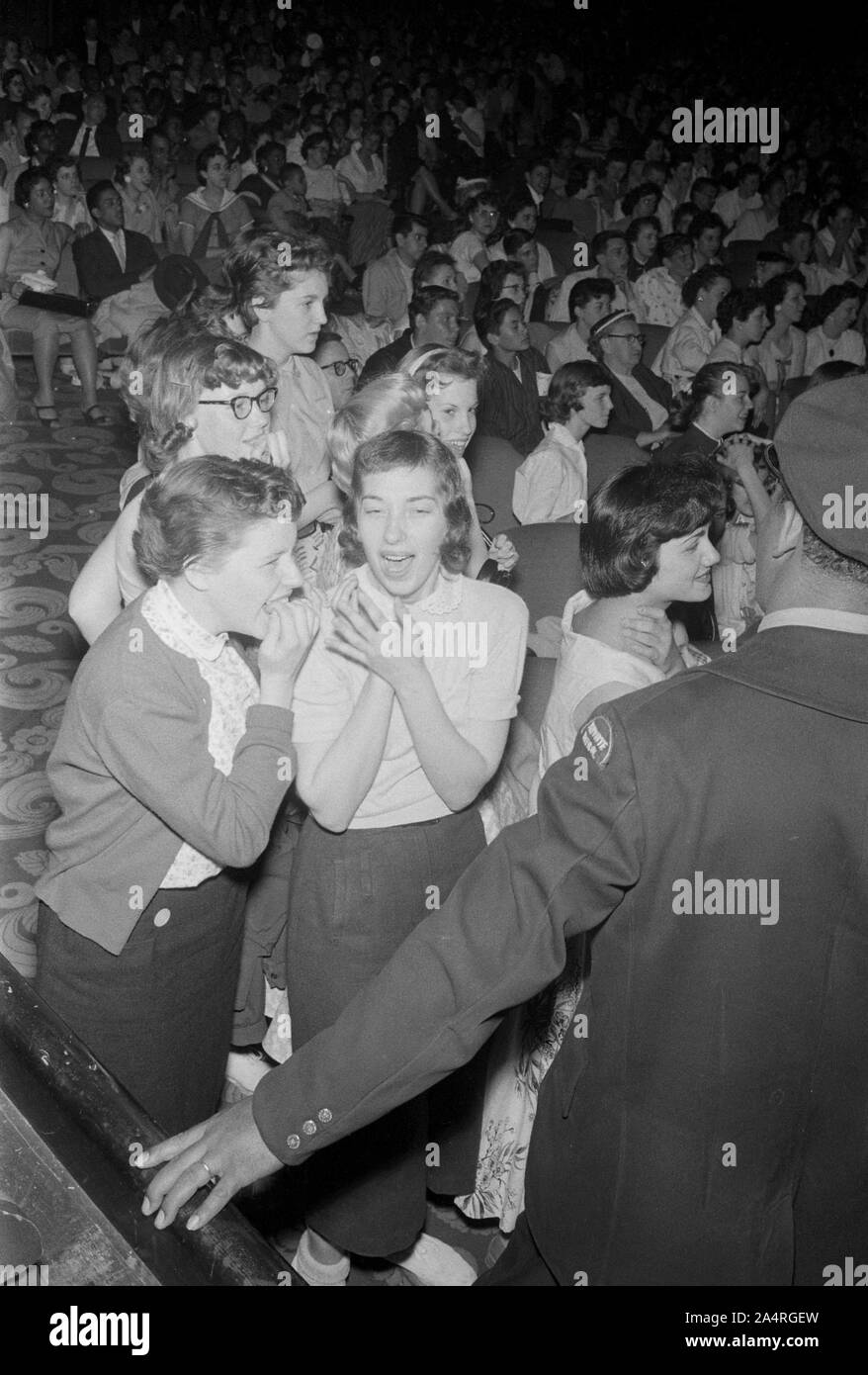 Elvis Presley fans reacting to his performance at the Fox Theater, Detroit, Michigan, May 25, 1956. Stock Photo