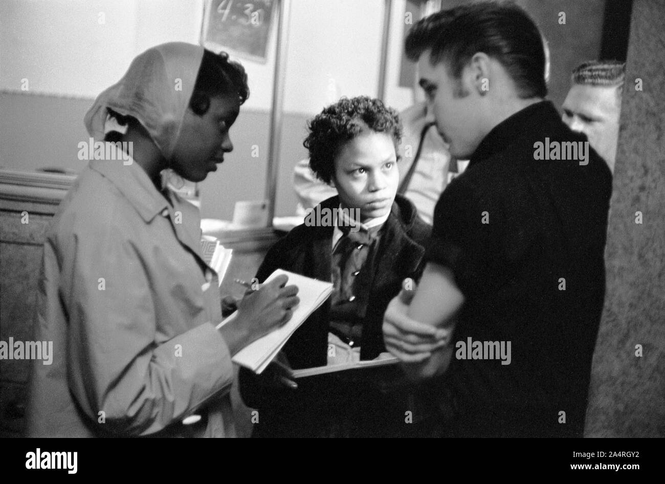 Elvis Presley speaking with young reporters at the Fox Theater in Detroit, May 25, 1956. Stock Photo