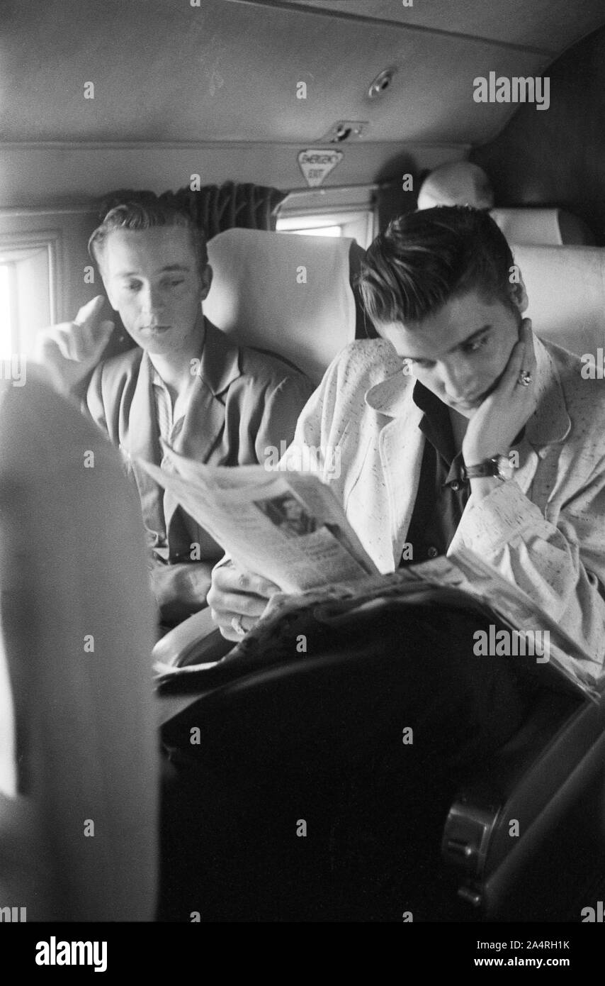 Elvis Presley and his cousin Gene Smith on a bus travelling on tour. The exact date is unknown, but it is probably May 27, 1956 Stock Photo
