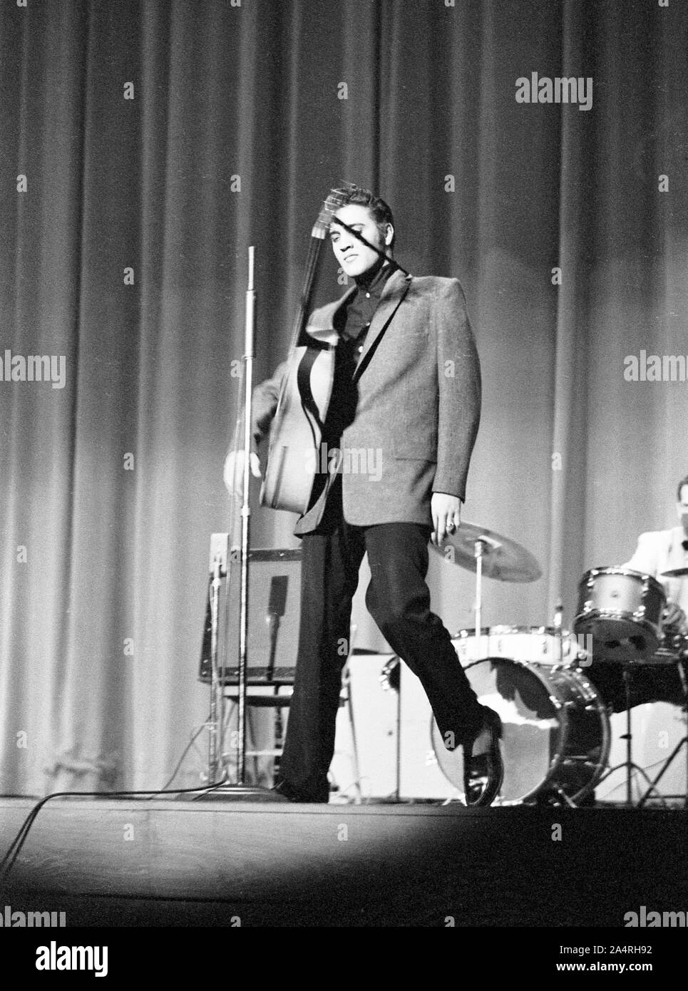 Elvis Presley performing on May 26, 1956. The performance took place at the Veteran's Memorial Auditorium, Columbus, Ohio. Stock Photo