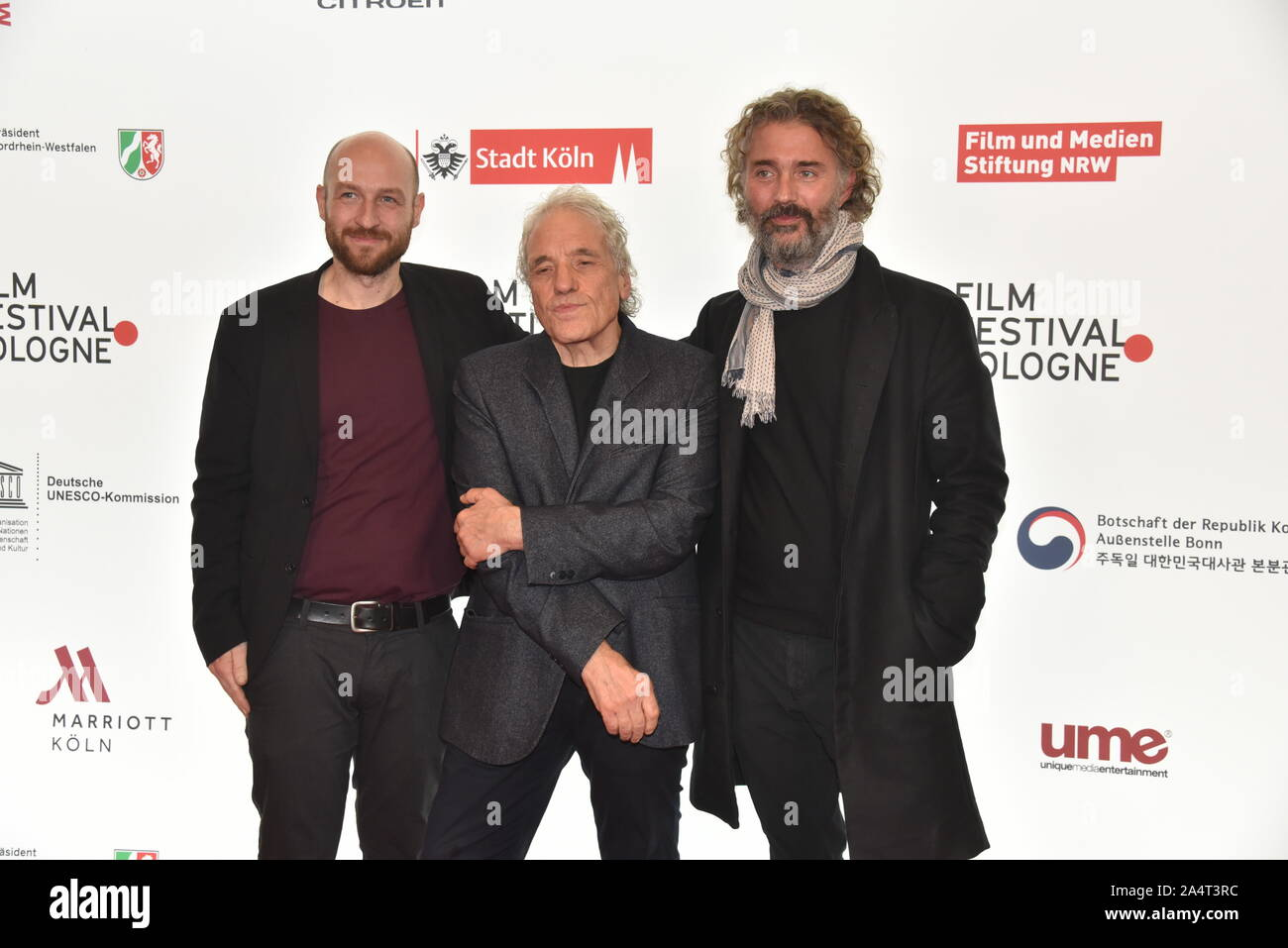 """Cologne, Germany. 15th Oct, 2019. Program director Johannes Hensen, l-r, the US American director Abel Ferrara and film producer Michael Weber come to screen the film """" Tommaso """" at the Film Festival Cologne, international film and television festival. Credit: Horst Galuschka/dpa/Alamy Live News Stock Photo"""