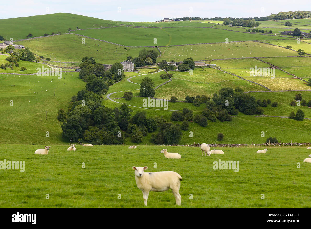 A long distance shot of Castern Hall, a privately owned 18th century country house or home situated in the Manifold Valley near Ilam Staffordshire Stock Photo
