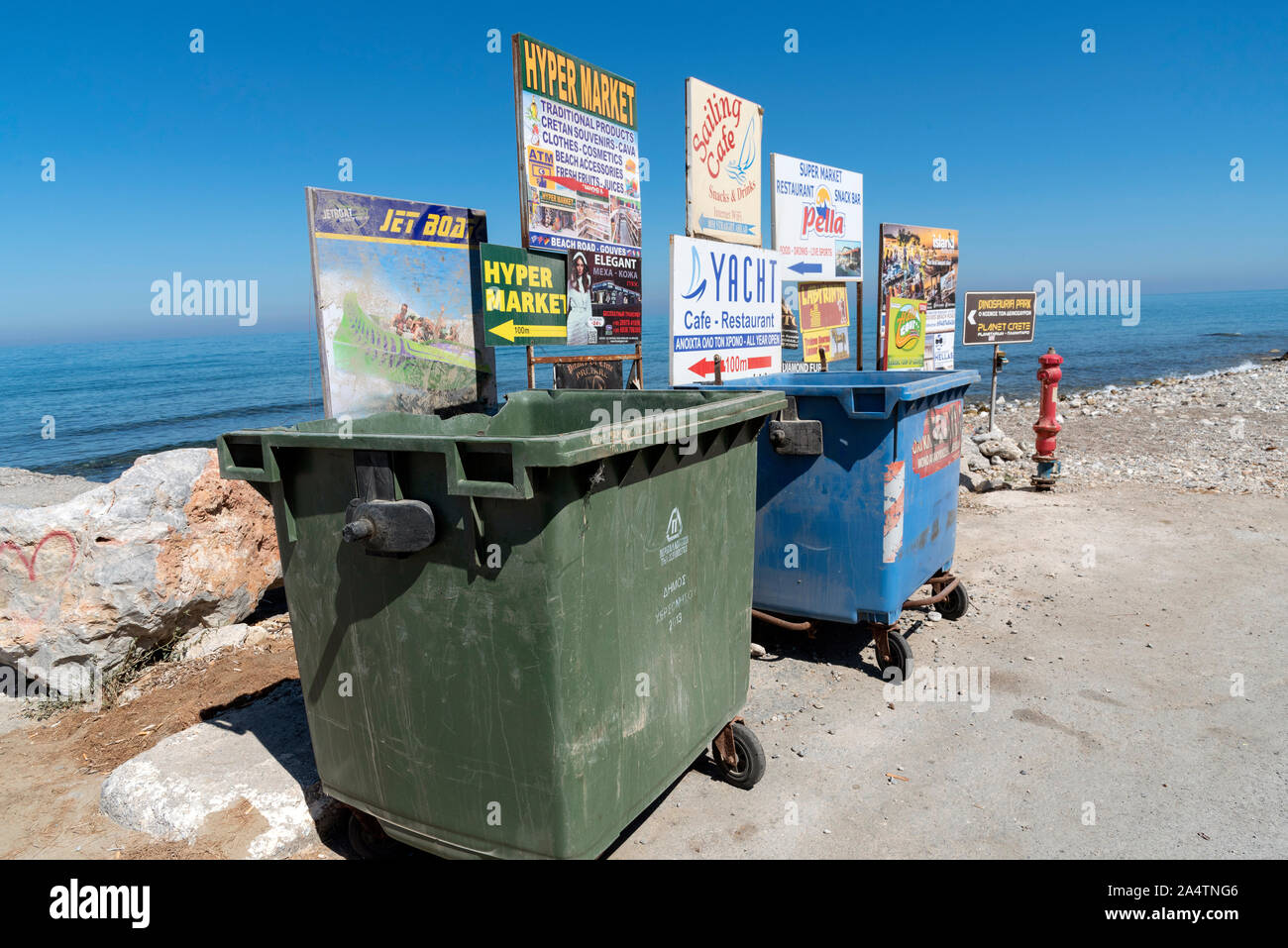 Gouves, Crete, Greece, October 2019.  Rubbish and recycling bins on the beach road in the seaside resort of Gouves, Crete. Stock Photo