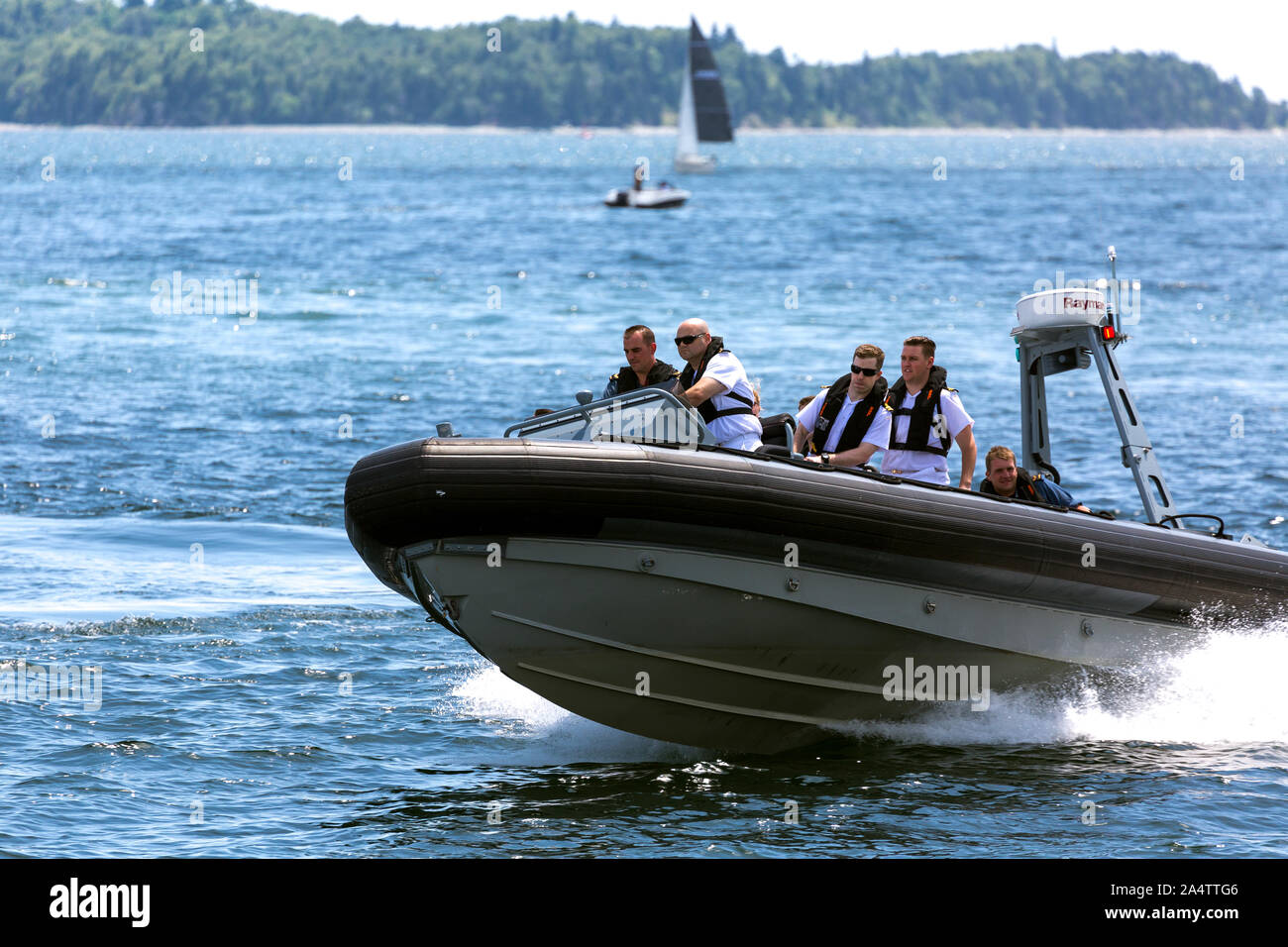Canada, Halifax. Nova scotia. Harbour  Waterfront . Canadian Navy officers sailing Rib craft in Halifax harbour. Stock Photo