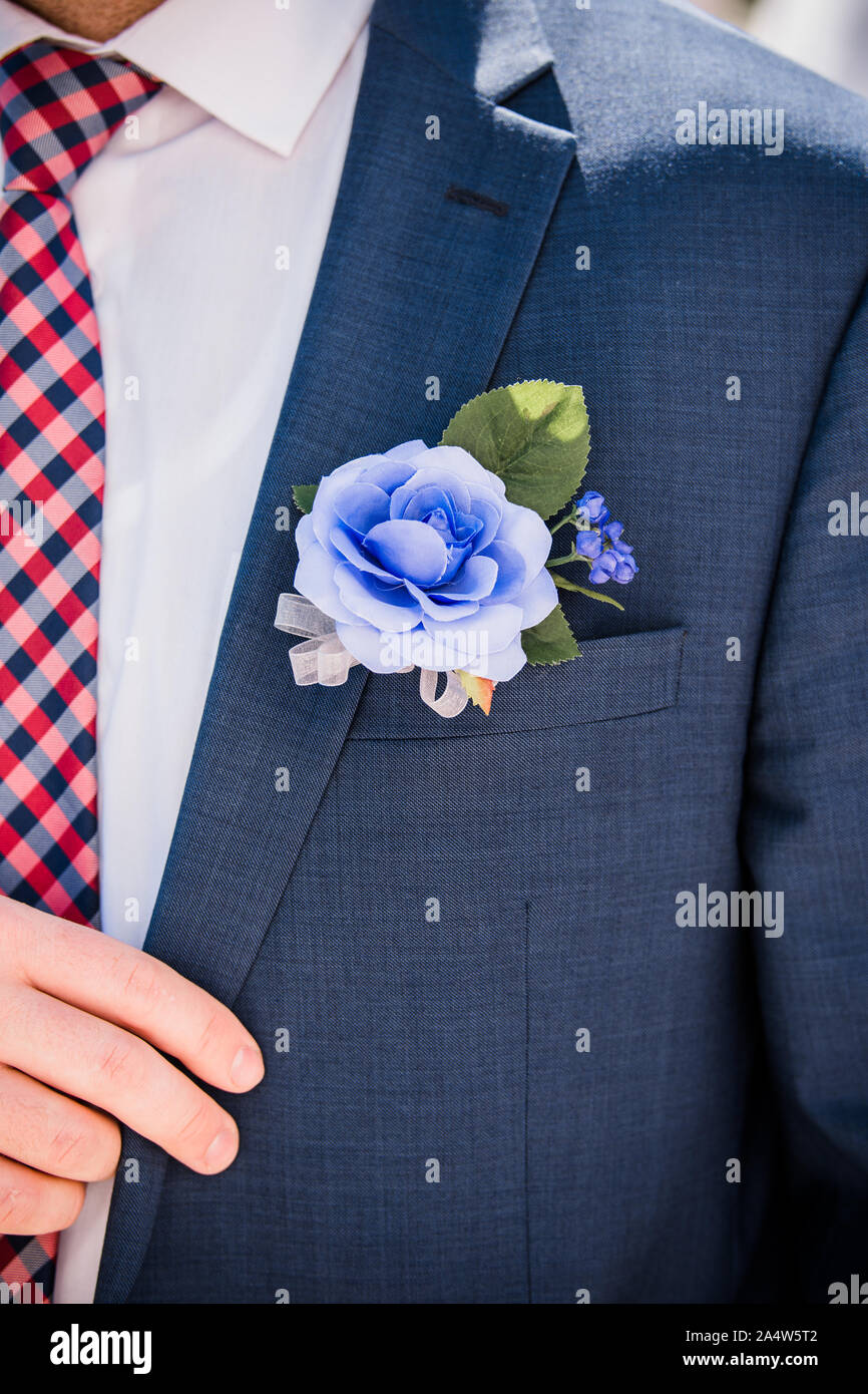 Groom sports floral boutonniere on stylish suit Stock Photo