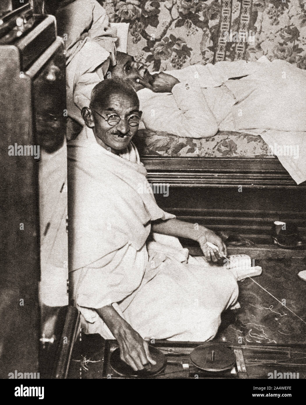 Mohandas Karamchand Gandhi, aka Mahatma Gandhi, 1869 – 1948. Indian activist, leader of the Indian independence movement against British rule.  Seen here at the Round Table Conference, 1931. From The Pageant of the Century, published 1934. Stock Photo