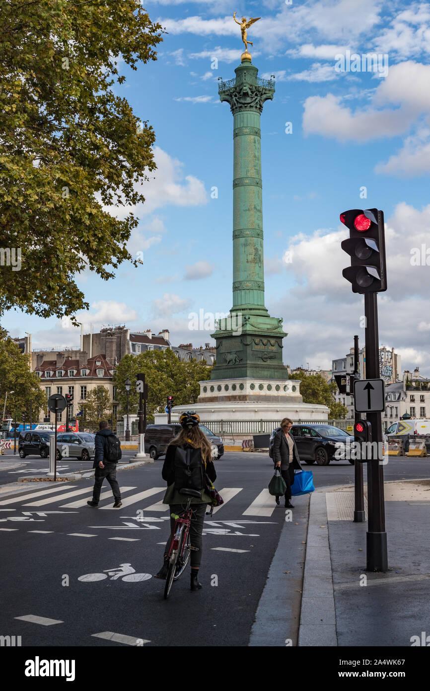 Paris, France - 3rd October, 2019:  Pedestrians walking by E-scooter at The Place de la Bastille  in central paris Stock Photo