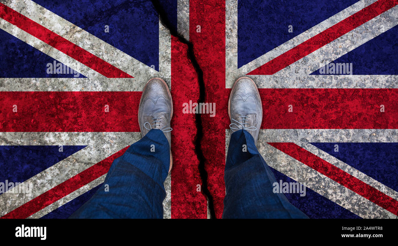 Business man standing on cracked flag of United Kingdom. Brexit concept Stock Photo