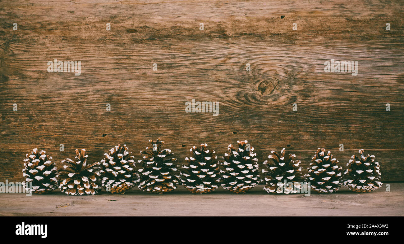old wooden background with fir cones. the concept of a new year Christmas Stock Photo