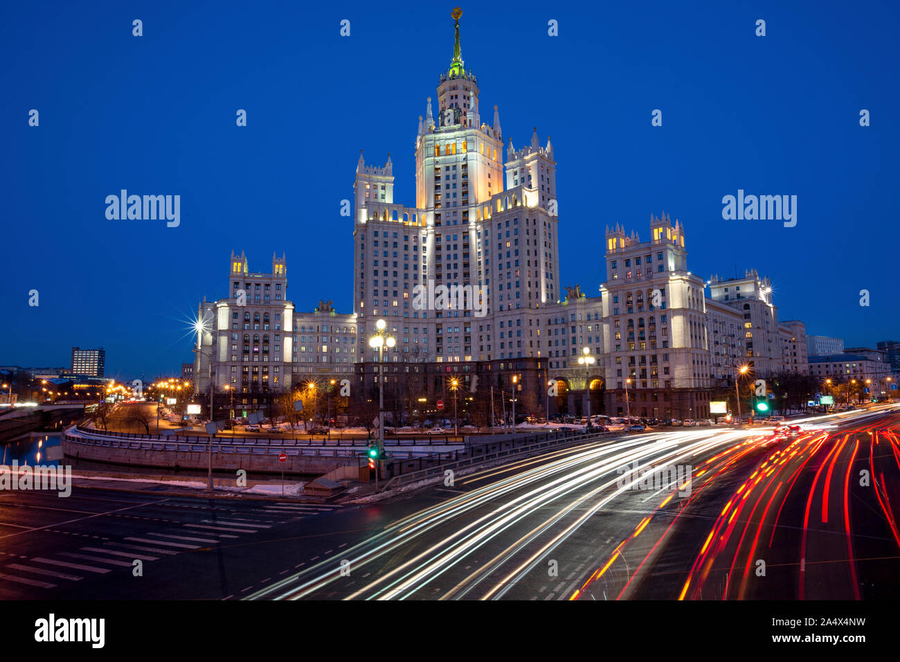 View of the skyscraper on Kotelnicheskaya Embankment and Traffic Trails at Dusk in center of Moscow city, Russia Stock Photo