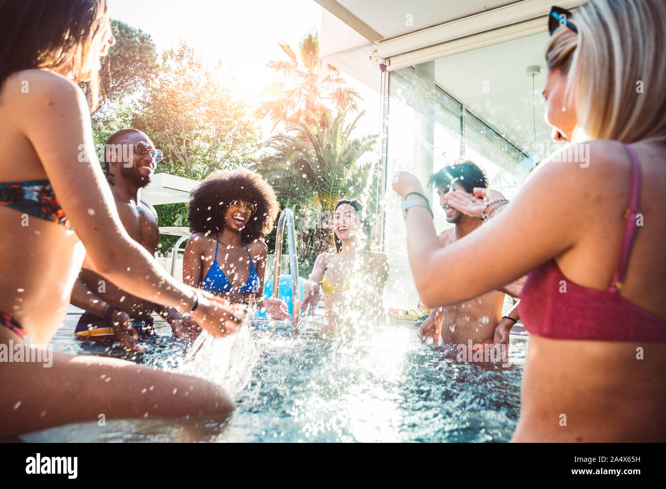 Group of multiracial friends having fun at pool party Stock Photo